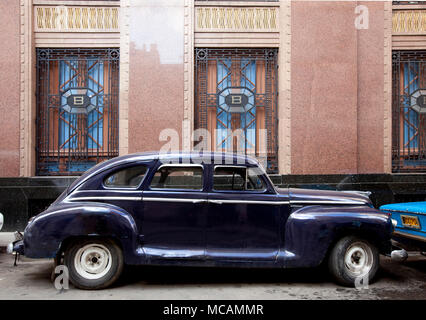 Vintage car parked next to the Bacardi Rum building in Havana, Cuba - Stock Image