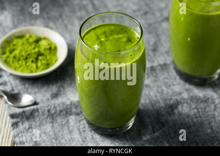 Healthy Homemade Matcha Breakfast Smoothie with Spinach and Banana - Stock Image
