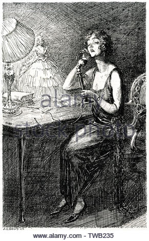 Slightly haughty lady speaking on an early 'candlestick' telephone.     Date: 1923 - Stock Image