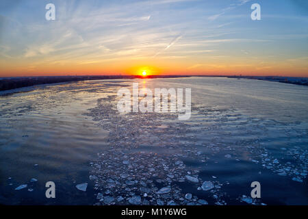 Aerial Sunset over Frozen River - Stock Image