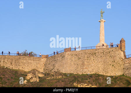 Outer defense walls of the Belgrade fortress Kalemegdan with the statue of Victor, symbol of the city. Serbia. - Stock Image