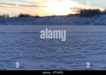 Winter landscape snow covered expanses. A park in the winter in the snow. Road on winter day. - Stock Image