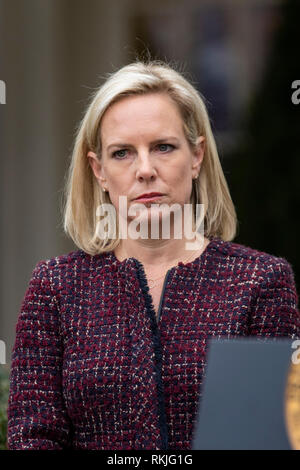 Homeland Security Secretary Kirstjen Nielsen looks on as US President Donald Trump speaks to reporters in the Rose Garden of the White House on January 4, 2019. - Stock Image
