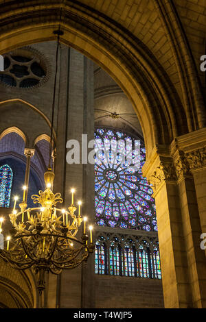 Chandelier and architectural details inside Cathedral Notre Dame, Paris France - Stock Image