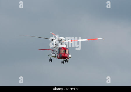 S92A UK Coastguard Sikorsky Helicopter on Execise off the Morayshire coast in Scotland. - Stock Image