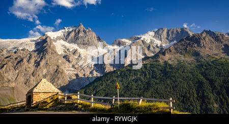 The Oratory of Le Chazelet at sunset with the peaks of La Meije and its glacier. Ecrins National Park, La Grave, Hautes-Alpes, European Alps, France - Stock Image