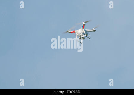 A personal drone with camera hovering - Stock Image
