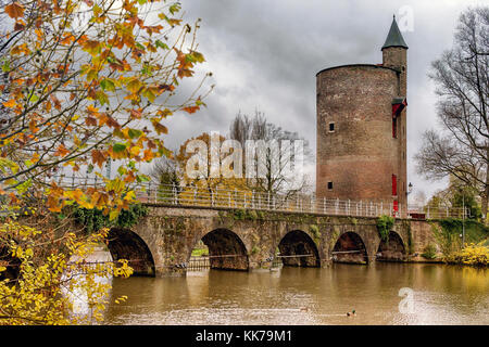 The Minnewater Bridge, Bruge, Belgium, EU. Known as the lovers bridge, Minnewater lake and park, once a mooring - Stock Image