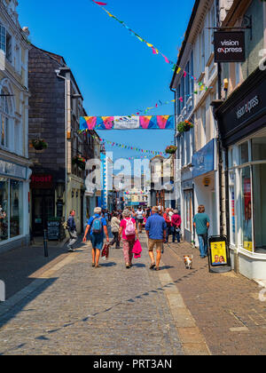 12 June 2018: Falmouth, Cornwall, UK - People shopping in Church Street on a beautiful sunny summer day. - Stock Image