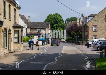 A view of the HIgh Street in the pretty village of Harrold on a sunny Summer day; Bedfordshire, UK - Stock Image