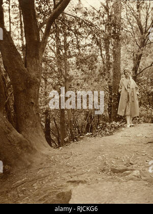 Woman walking in a wood. - Stock Image