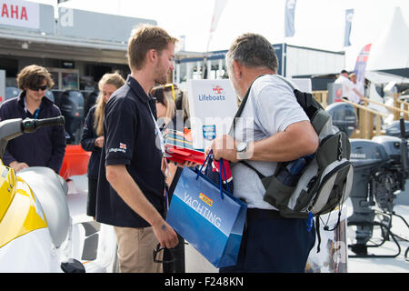 Southampton, UK. 11th September 2015. Southampton Boat Show 2015. A visitors speaks to a RNLI team member on their - Stock Image