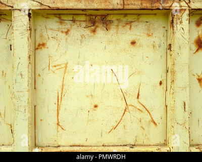 Old rusty yellow painted metallic construction as a full frame background. - Stock Image