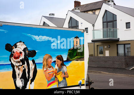 UK, Northern Ireland, Co Londonderry, Castlerock, painted ice cream van and seafront homes - Stock Image
