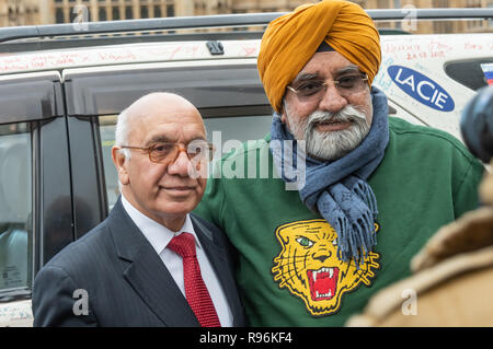 London, UK. 19th December 2018. Virendra Sharma, Labour MP for Ealing Southall, welcomes The Turban Traveller, a Sikh with a film crew from Creative Concept Films in Delhi who arrived in London today after driving overland from Delhi, visiting 33 countries and around 50 cities in 150 days, covering 33,000km - over 20,000 miles. Later The Turban Traveller aims to drive the whole length of North and South America. Peter Marshall/Alamy Live News - Stock Image
