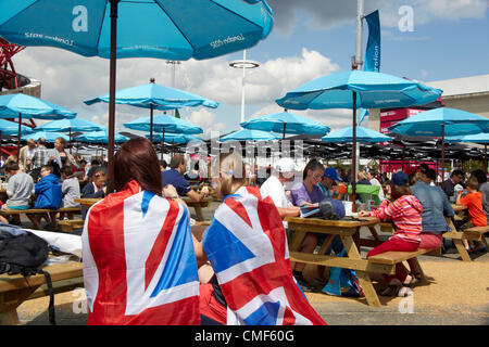 People wearing Union Jack flags in food area at Olympic Park, London 2012 Olympic Games site, Stratford London E20 - Stock Image
