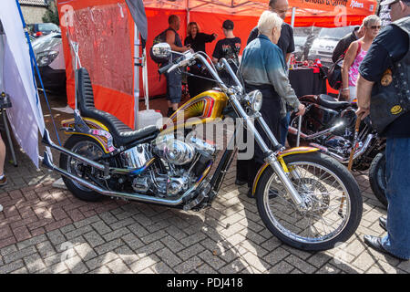 Customized hard tail chopper motorcycle  with glitter paint fuel tank on display at Calne bike meet - Stock Image