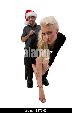 man looking towards lady with magnifier on isolated background - Stock Image