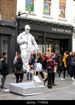Street entertainer in Covent Garden in workman outfit - Stock Image