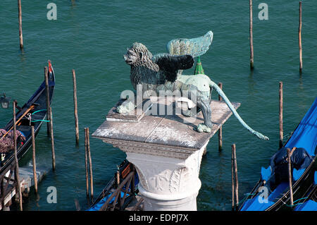 Bronze statue of winged Lion symbolising St Mark the Evangelist on column in piazzetta Venice Italy which dates - Stock Image