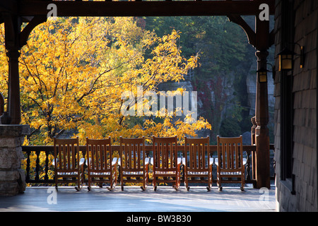 Row of rocking chairs on a resort porch, Mohonk Mountain House, New Paltz, NY, USA - Stock Image