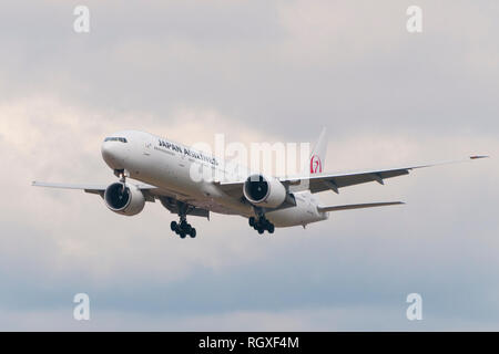 London, Uk - August 6, 2013 - A Japan Airline airplane lands at Heathrow Airport in London - Stock Image