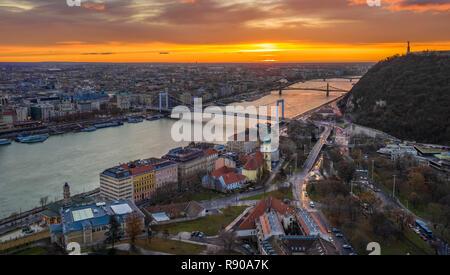 Budapest, Hungary - Golden sunrise over Budapest, with Elisabeth Bridge, Liberty Bridge and Statue of Liberty - Stock Image