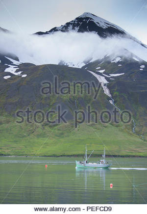 A fishing boat in the harbor of Siglufjordur, a fishing village in the northernmost part of Iceland. - Stock Image