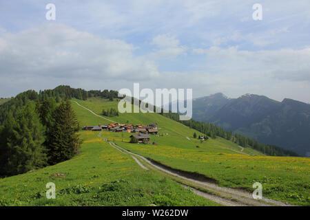 Idyllic Swiss village Obermutten in early summer. - Stock Image