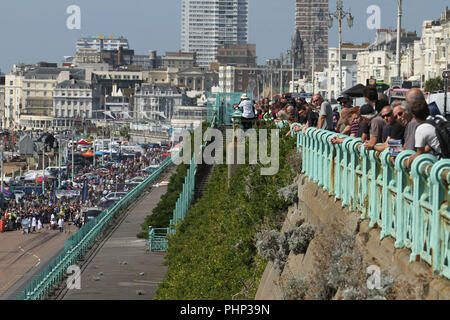 Brighton, UK. 1st September 2018: People watching the National Speed Trials that run along Madeira Drive in Brighton​ on 1​ September 2018.   The Pier, in the central waterfront section, opened in 1899 houses amusement rides as well as food kiosks.Credit: David Mbiyu /Alamy Live News - Stock Image
