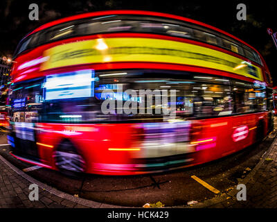 Red London Bus, with Fish Eye lens, Long exposure - Stock Image