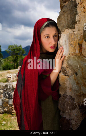 Mary Magdalene standing at the entrance of the empty tomb of Jesus on Easter morning - Stock Image