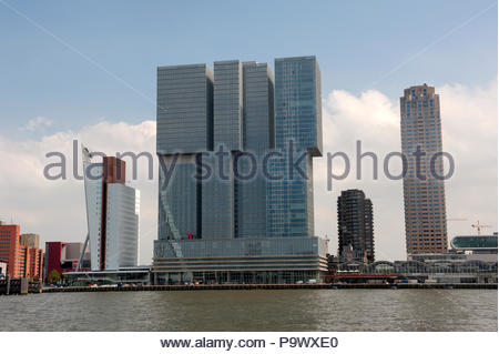 Rotterdam The Netherlands View across the River Nieuwe Maas to the skyscrapers on the Wilhelminakade. Central 'De Rotterdam' designed by Rem Koolhaas. - Stock Image
