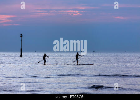 Dunkirk. France. 09.12.16. Stand up paddle surfing or stand up paddle boarding is an offshoot of surfing that originated in Hawaii. - Stock Image