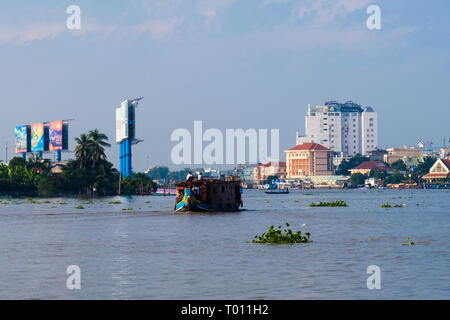 Hau River scene with clumps of Water Hyacinth floating downstream in Mekong Delta. Can Tho, Vietnam, Asia - Stock Image