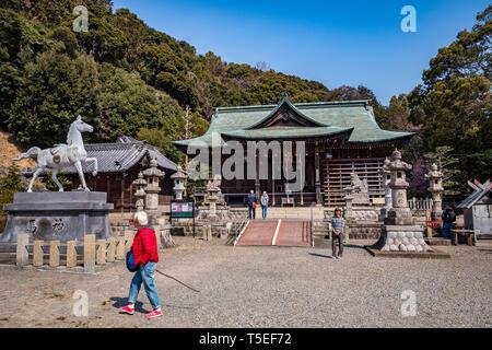 27 March 2019: Gamagori, Japan - Visitors at the Katahara Shinto Shrine, Gamagori. - Stock Image