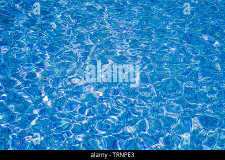 Swimming pool water surface background - Stock Image