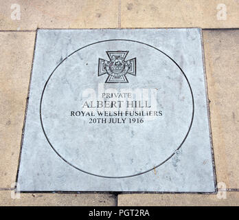 Plaque at foot of Manchester England war memorial showing Victoria Cross awarded Private Albert Hill Royal Welsh Fusiliers 20th July 1916 - Stock Image