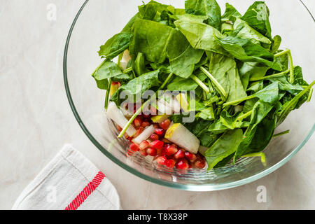 Pomegeranate and Pear Salad in Glass Bowl Ready to Make. Organic Food. - Stock Image