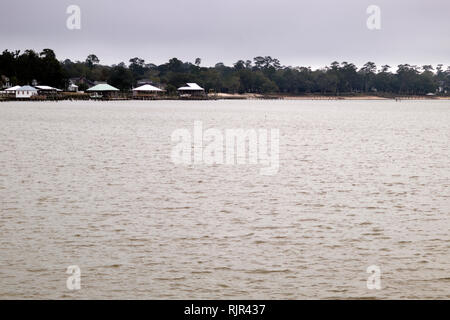The east shore of Mobile Bay taken from the pier at Fairhope, Alabama on a dreary winter day in February. - Stock Image