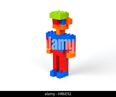 Colourful boy, man, male with jug-ears and a green cap constructed of Lego bricks - Stock Image