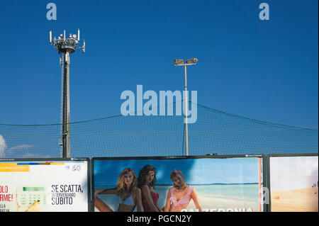 adverstising outside a football court, Italy - Stock Image
