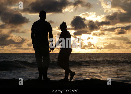 Couple on beach at sunset Costa Rica Pacific coast, the Osa Peninsula - Stock Image