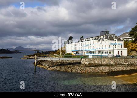 Lochalsh Hotel with distant view of Skye Bridge, Kyle of Lochalsh, Wester Ross, Highland Region, Scotland - Stock Image