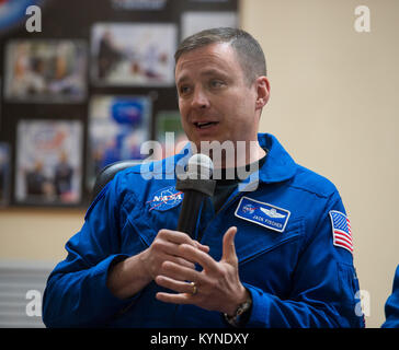 Expedition 51 Flight Engineer Jack Fischer of NASA, answers a question during a press conference on Wednesday, April - Stock Image