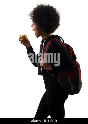 one mixed race african young teenager girl woman eating apple in studio shadow silhouette isolated on white background - Stock Image