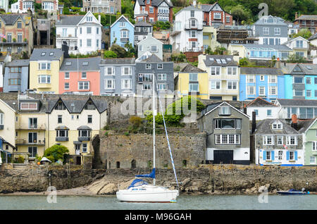 Multi-coloured houses lining the banks of the RIver Dart in Devon - Stock Image