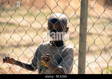 A young indigenous Jola tribe boy in the village of Berending, The Gambia, West Africa. - Stock Image