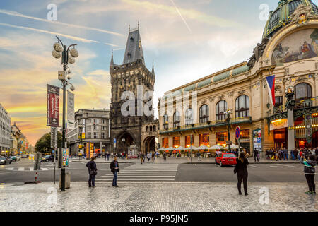 The Powder Tower separating Old Town from New Town with the Municipal House as the sun goes down in Prague, Czech Republic - Stock Image