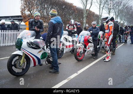 Racing motorcyclists queue up in the snow to race at the 76th annual Members Meeting at Goodwood, West Sussex. The race had to be cancelled. - Stock Image